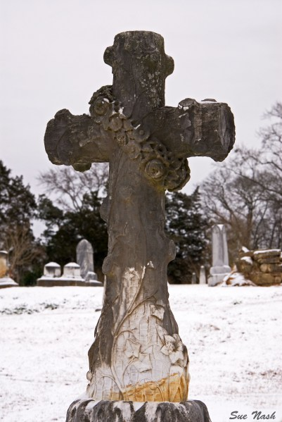 Old stone cross in local, historic cemetery